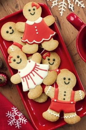 Gingerbread men on a red platter